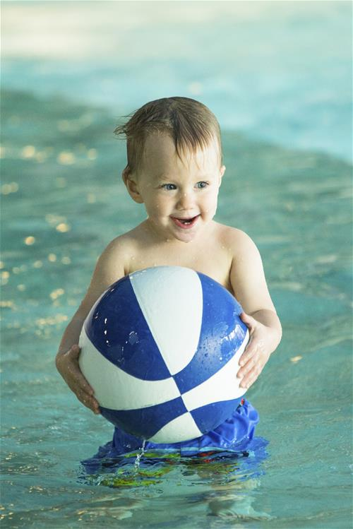 Baby with a Basketball in Pool
