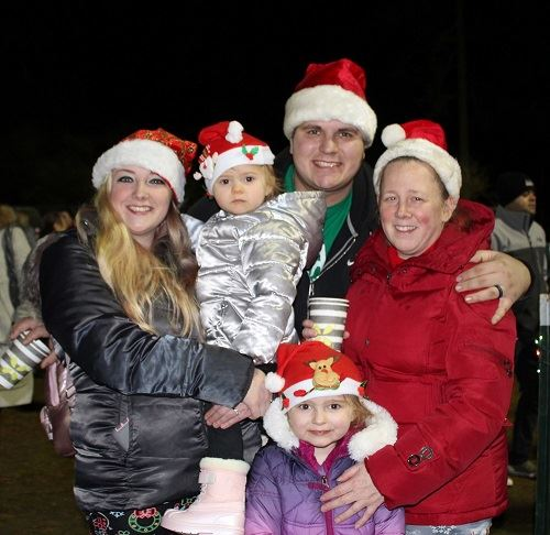 Five Family Members in Red Santa Hats Enjoy 2019 Tree Lighting