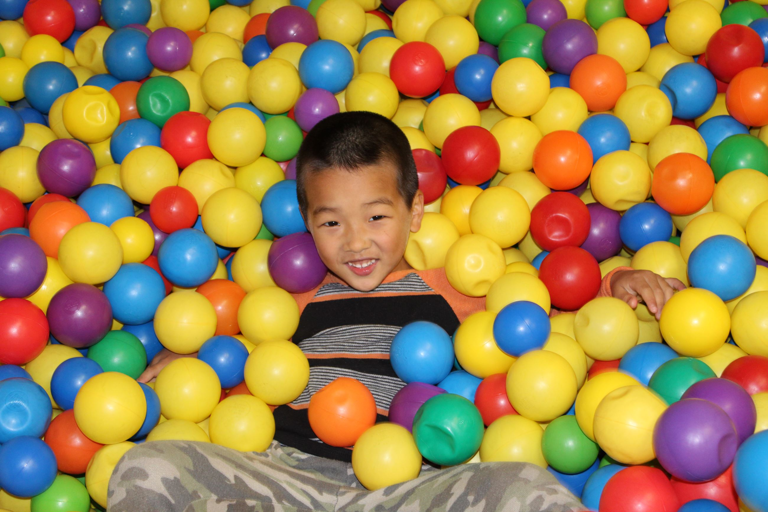 Boy in ball pit at indoor playground